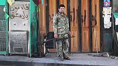 Free Syrian Army soldier with machine gun in Aleppo.jpg