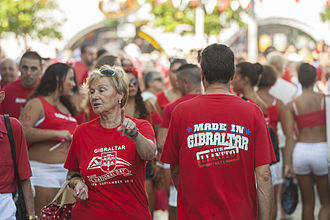 Gibraltar National Day - Gibraltarians dress in their national colours of red and white on National Day.