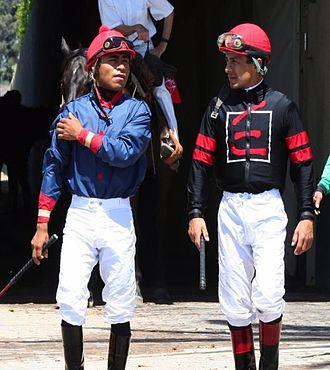 Martin Garcia (jockey) - García with fellow jockey Victor Espinoza (left), at Hollywood Park racetrack in 2008