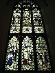 A stained glass panel depicting Biblical scenes at a historic church in Scotland