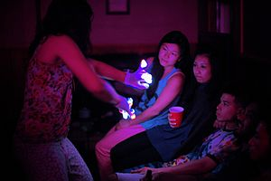 Gloving - Picture of a girl giving a light show with LED gloves.