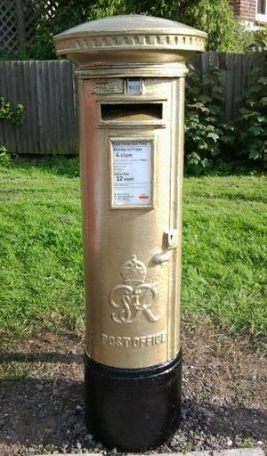 2012 Summer Olympics and Paralympics gold post boxes - The gold post box in Arleston, Telford, that commemorates the gold medal won by paralympian Mickey Bushell.
