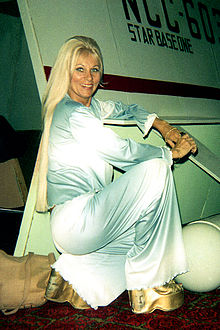 Whitney posing with a Star Trek prop at a science fiction convention, 1975