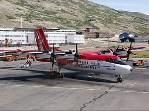 Air Greenland - Air Greenland used the 102 and 103 variants of the Dash 7. The latter of this aircraft is equipped with a front cargo section, the Dash 7 on the appron at Kangerlussuaq Airport (2001)