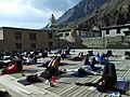 Group of Tourist practicing yoga at ancient Chos-Khor Monastery Himachal India.jpg