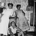 Group of lady friends pose by a television inside a home on South Street, Raleigh, NC, 1957. L-R- Mary Eliza GREEN, Jeanette Brown Adams FERGUSON, and Delois Marie JOHNSON. Mary Eliza worked at St. (26454522962).jpg