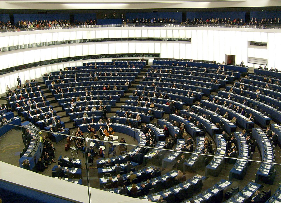 Hemicycle of European Parliament, Strasbourg, with chamber orchestra performing-cropped