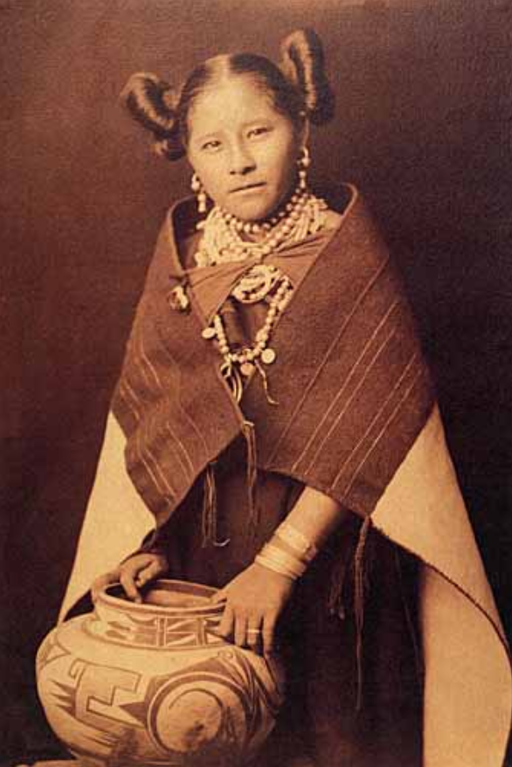 Hopi woman with a traditional pot and traditional clothing