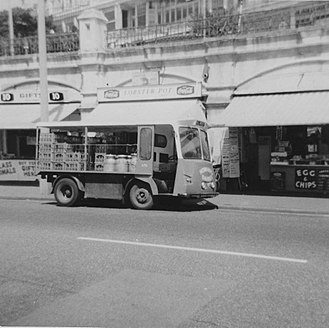 Wales & Edwards - A Freightliner belonging to Howards Dairies, No. 670, registration OHJ 420F delivering milk to cafes by Southend Pier, Essex, around 1970