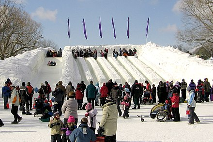 People on ice slides during Winterlude, an annual winter festival held in Ottawa. Ice slide Winterlude Ottawa 2007.jpg