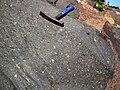 Impact breccia (Sandcherry Member, Onaping Formation, Paleoproterozoic, 1.85 Ga; High Falls roadcut, Sudbury Impact Structure, Ontario, Canada) 5 (40792900253).jpg