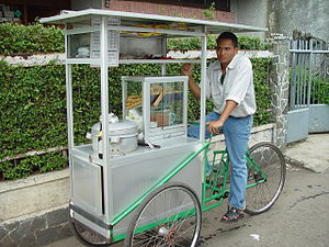 Street food of Indonesia - Bakso (meatball) seller on tricycle in Bandung