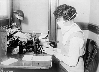 History of virology - A woman working during the 1918–1919 influenza epidemic. The face mask probably afforded minimal protection.
