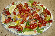Insalata di pomodorini, calamari e gamberetti