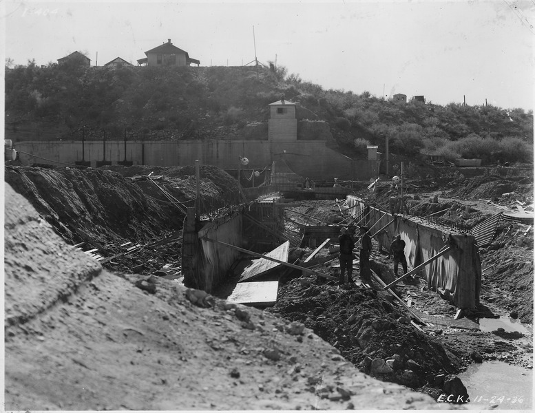 File:Intake diversion dam. View from south end of 80' section adjacent to north abutment, showing new cut-off walls. - NARA - 294581.tiff