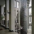 Interieur, zicht op trappenhuis (met oude schoorsteen als spil) - Boxmeer - 20384795 - RCE.jpg