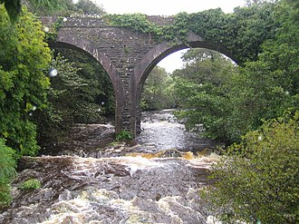 Tralee and Dingle Light Railway - Disused railway viaduct looking upstream on the Finglas River from Curraduff Bridge on the N86 road to Dingle