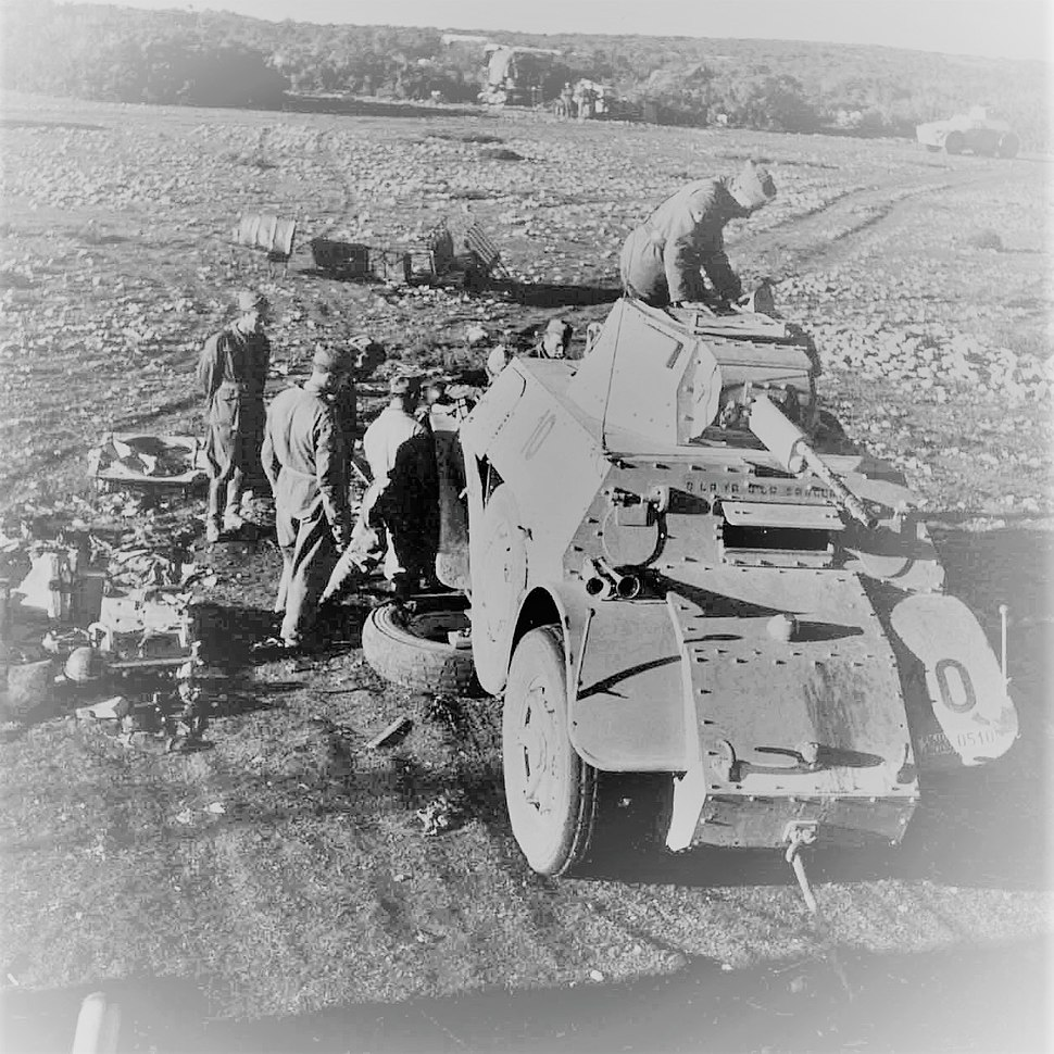 Italians repairing an amoured vehicle in East Africa