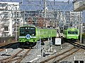 JRW Osaka-Higashi Line 201 series and Yamatoji Line 103 series Kyuhoji Station.jpg