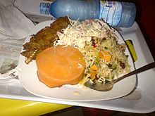 Jamaican Rice served with grilled Fish and Mixed Salad and moi moi ...