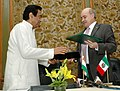 Kamal Nath and the Minister of Economy of Mexico, Mr. Eduardo Sojo Garza-Aldape are exchanging the signed documents of the MoU on the establishment of a Bilateral High Level Group on Trade.jpg