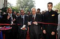 Kapil Sibal inaugurating the exhibition at the India Telecom 2012, in New Delhi on December 13, 2012. The Minister of State for Communications & Information Technology and Shipping, Shri Milind Deora is also seen.jpg