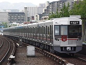 Kita-Osaka Kyuko Railway - Kita-Osaka Kyuko 9000 series train (between Momoyamadai Station and Senri-Chūō Station)