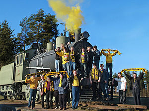 "Lapinlahti -  A Locomotive Tv1 No 940 –""The Finnish Cup loco""- at Lapinlahti, with Supporters of the soccer team KuPS after a decisive Cup victory"
