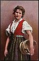 Kvinne i nasjonaldrakt holder en tine under armen (22666330187).jpg