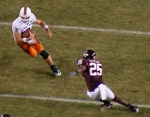 Kyle Wright - Wright (left) carries the ball against Virginia Tech