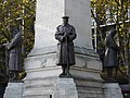 LNWR War Memorial, Euston - southwest, southeast and northeast statues 01.jpg