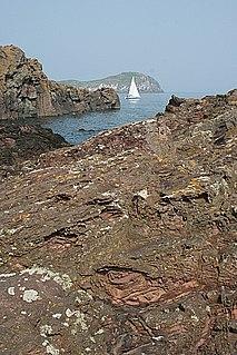 Mugearite Oligoclase-bearing basalt, comprising olivine, apatite, and opaque oxides