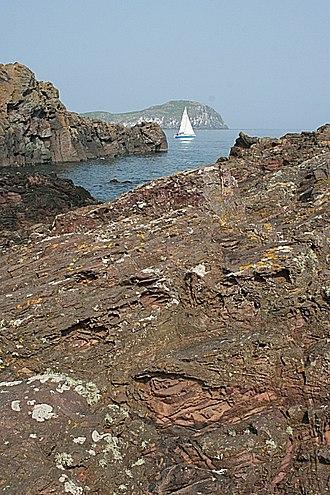 Mugearite - Mugearite lava flow (on right); flow on left is hawaiite; at North Berwick, Scotland