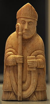 Photograph of an ivory gaming piece depicting a bishop