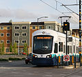 Link train passing new apartments in Rainier Valley (8755134484).jpg