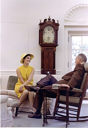 Oval Office grandfather clock - The previous longcase clock in the Oval Office, behind Lynda Bird Johnson and Lyndon Johnson (1967)