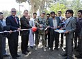 MSG Jeremy Swistak cuts the ribbon that to start construction on Mostoufiat road in Herat.jpg