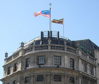 Flag of Malaysia - The Malaysian flag flying above the Tourism Malaysia office in Trafalgar Square, London. The flag of Uganda is seen by its side over Uganda House.