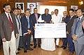 Mallikarjun Kharge receiving a cheque of Rs. 937 crore from the Vice Chairman, Rail Land Development Authority (RLDA), Shri Y.P. Singh, in New Delhi. The Minister of State for Railways, Shri K.J. Surya Prakash Reddy.jpg