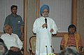 """Manmohan Singh addressing the gathering after receiving a book titled """"Indian Industrial Development and Globalisation"""" from the Chairman, National Commission on Enterprises in the Informal Sector of India.jpg"""
