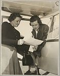 Marie Richardson and Grace Cavanagh next to an Auster monoplane at Bankstown Aerodrome during the second Australian Women Pilots' Association Reliability Trials, Sydney, September 1954 (16289751155).jpg