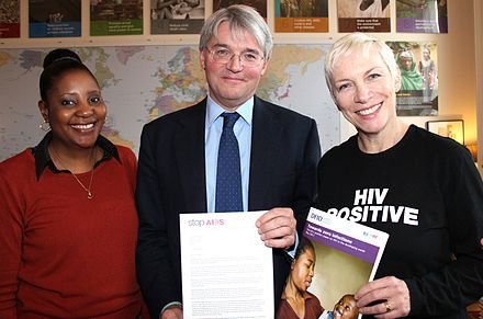 HIV campaigners, Memory Sachikonye (left) and Lennox (right) meet with the UK's Secretary of State for International Development Andrew Mitchell in December 2011 Memory and Annie call on UK to lead efforts to bring end to AIDS.jpg