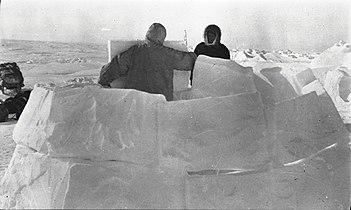 Men building a snowhouse at M'Clure Strait (51118).jpg