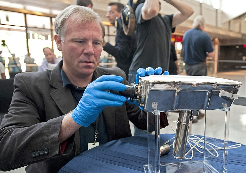 Mike Simons, Director of the National Electronic Museum in Baltimore assembles an Apollo TV camera for display