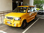Mitsubishi Freeca of Taoyuan International Airport Co. Ltd. Parked in Front of Observation Tower, Aviation Museum 20130928.jpg
