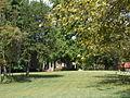 Monor as seen from driveway, hidden behind trees.JPG