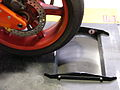 Motorcycle rear wheel on dyno roller.jpg