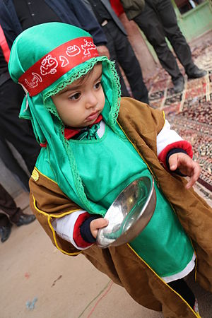 "Sukayna bint Husayn - An Iranian child in Mourning of Muharram with red Headband written ""O Ruqayyah""."
