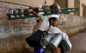 Two dabbawalas in Mumbai delivering meals packed in tiffin carriers Mumbai Dabbawala or Tiffin Wallahs- 200,000 Tiffin Boxes Delivered Per Day.jpg