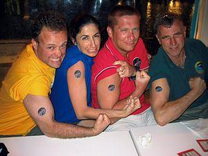 NEEMO 9 crew tattoos.jpg